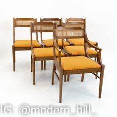 Paul Mccobb Style Walnut & Cane Dining Chairs - set of 6 These Chairs are 22.25 Wide and 23.25 Deep by 33 High with a 24.75 Arm Height and 18.25 Inch Seat Height This set is available in what we call Restored Vintage Condition. Upon purchase it is fixed so it's free of watermarks, chips or deep scratches with color loss; as well as thoroughly cleaned - at no extra charge but this takes a bit longer to ship than if you don't choose this option.
