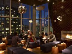 18 stories high atop The James Hotel in Soho, JIMMY is a contemporary interpretation of the classic pub, with a 1970's New York twist. Curated by David Rabin and Johnny Swet, the atmosphere is intimate and refined, with lingham wood floors, swank modular furniture, dark cinnamon glazed tile walls, and a working fireplace – all surrounded by 14' windows with panoramic views of Midtown, Wall Street, the Hudson River, and the bridges spanning the East River.