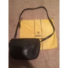 Authentic Vintage Black Fendi Cross Body Bag This bag is 100% authentic! It is a great size! It just has one white mark on the front (shown in a close up photo). Comes with the yellow Fendi bag as photographed! There is also a little peeling on the strap as shown. FENDI Bags Crossbody Bags