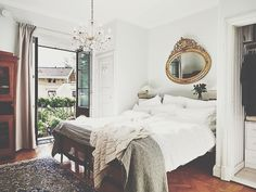 gold mirror, neutral bedding