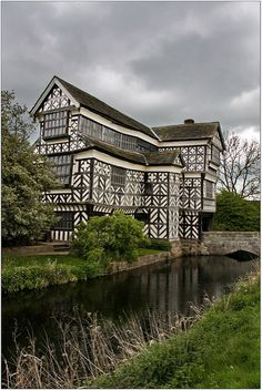 Little Moreton Hall ༺✿༺ is a moated half-timbered manor house built for the prosperous Cheshire landowner, William Moreton, about 1508 the remainder was constructed in stages by successive generations of the family until about Cheshire, England. Beautiful Buildings, Beautiful Places, Little Moreton Hall, English Manor Houses, Medieval Houses, England And Scotland, English Countryside, Historic Homes, Old Houses