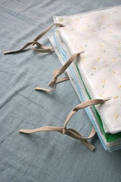 quiet book - that's a nice simple way to bind the pages together, and you can interchange pages easily as your child develops!
