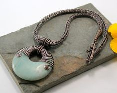 Alkebulan - Copper Viking knit necklace with Amazonite wire wrapped agogo donut pendant