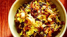 Cashew pulao (kaju pulao) | A colourful fluffy rice dish flavoured with cardamom and clove, and dotted with cashews and dried fruit.