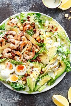 Grilled and Skinny Lemon Garlic Shrimp Caesar Salad with a lightened up creamy Caesar dressing is a complete meal in a salad and a family favourite! | http://cafedelites.com