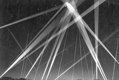 WW1. British civilian defense forces fire on German Navy airship caught in searchlights.