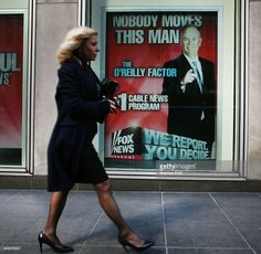 An advertisement for Bill O'Reilly's top-rated Fox News show is displayed in the window of the News Corporation headquarters on April 5, 2017 in New York City. Following allegations that he sexually harassed several women, over a dozen major advertisers, have pulled their ads from 'The O'Reilly Factor.'