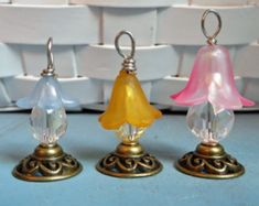 This listing is for one (4) adorable Flower Fairy Lanterns with decorative shepherd hook hangers. Perfect to add some color and fun to your miniature garden, fairy garden, terrarium or miniature doll house. Measurement of bead from loop to bottom of faceted glass bead is about 1 inch.  The lanterns are shown in pink However, also available in Yellow, Blue, Red, Lime Green, Purple, orange, dark green, black, white  NOT FOR YOUNG CHILDREN _ CHOCKING HAZARD Decorative use only. Does not light…
