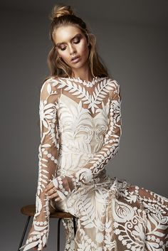 Avril gown from Rue De Seine Love Spell Collection. Bohemian long sleeve lace wedding gown with a deep v back and train. Perfect for the boho bride.