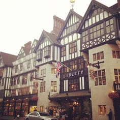 London - Liberty is like Harrod's bohemian, artsy, hip sister, who lives in a old tudor style mansion.  I would say I prefer Liberty (I love their prints and it's much less crowded), however, they do not have a chocolate bar so it's still up for debate.