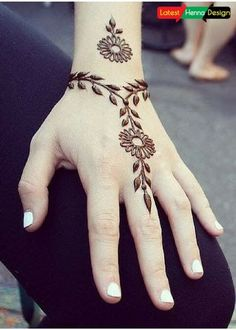 Simplest Mehndi Design:  On the back side of the hand, its look beautiful with simplest possible mehndi design.  http://www.latesthennadesigns.com/2017/05/latest-henna-designs-for-girls.html  #henna #hennadesigns #mehndi #mehndidesigns