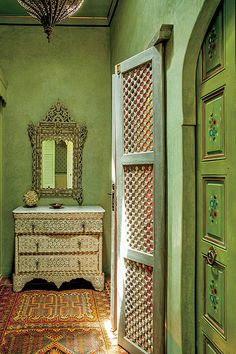 A dressing room features a mother-of-pearl bureau and matching mirror.