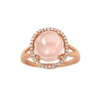 A Beautiful Dress Ring Featuring an Oval Shape, Champagne Pink Moonstone, Cabochon Cut and Pave set Diamonite Sparkles. The Setting is raised so that the stone can be seen in all its beauty and the Sparkles are set in a slightly undulating designer style. The base metal of this ring is Sterling Silver and Rose…