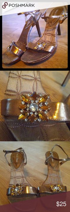 Jeweled Sandal Heels Metallic copper colored sandal style heels. Adjustable ankle strap. Gorgeous jeweled flower on toe strap of each heel. In excellent condition. Size 8. Brand Michael Antonio. Offers accepted. Michael Antonio Shoes Heels