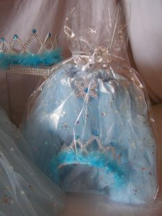 Princess Party Ideas.  Beautifully wrapped tutu and tiara FROZEN inspired favors.  Now 55% OFF! Shop www.myprincesspartytogo.com #princesspartyideas #frozen #frozenfavors