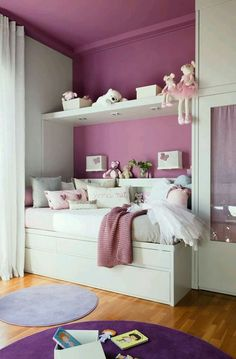 I love this design! This room could easily grow with a boy or girl. Obviously different colors for a boy... I could picture a nerf basketball net in the middle of the upper shelf. If a teen is into sports and has a lot of trophies, the upper shelf would make an awesome display!