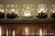 DIY Baby Food Jar Menorah. #Hanukkah #Menorah