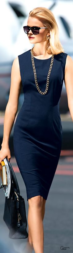 Add a long necklace to a shift dress to add some interest