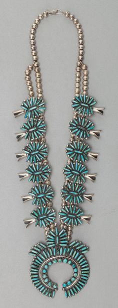 1895 Beautiful squash blossom necklace Dine' often wear. Heavy with turquoise and silver, hand-made finery.