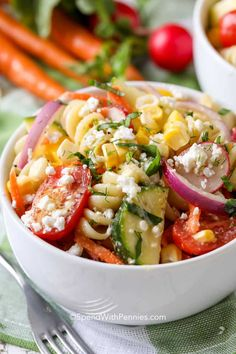 Summer Pasta Salad combines all of the fresh garden vegetables of the season with a light vinaigrette dressing, cheese, herbs and our favorite pasta.