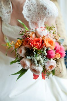 This bouquet was photographed by Michelle Lindsay and was created with peach juliet roses, coral charm peony, silver brunia, dusty miller, orange asclepsia, and free spirit roses.