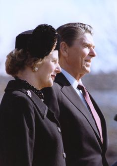 President Ronald Reagan and Prime Minister Margaret Thatcher on the south lawn during her Arrival Ceremony. 2/26/81.