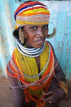 Bonda tribeswoman wearing traditional bead costume with beaded cap, large earrings and metal necklaces at weekly market, Rayagader, Orissa, India, Asia ...