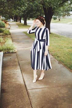 Modest navy and white striped dress with sash. Modest fashion, bridesmaid dresses, ruffles, and lace. www.daintyjewells.com