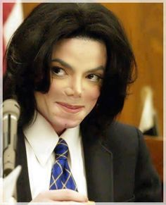 <3 Michael Jackson <3 - just love this picture - showing his mischievous side lol