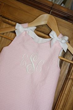 Baby girl bubble in pink gingham seersucker with white bows and monogram. $35.00, via Etsy.