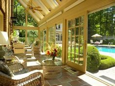 Stunning sunroom with sliding doors that open to a pool.  Such a tranquil, relaxing space!