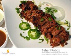 BEHARI KABOB                                . Tender beef fillet marinated with fried onions, and rich herbs & spices, and grilled till tender soft meat.