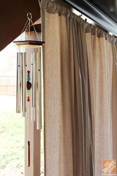 Turn an inexpensive drop cloth into a drapery panel by sewing a simple seam at the top of the fabric!