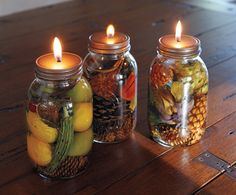 harvest oil candles with artichokes, olives, citrus peels, herbs and pepper corns