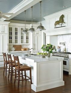 Love the painted ceiling with contrasting beams, and of course the white marble countertops and backsplash. #Kitchen