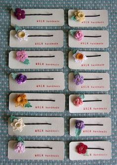 Tiny crochet flower hairpins. Great for a hand out with a cute saying on the card.
