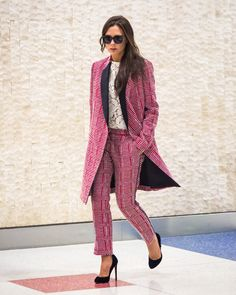 Victoria Beckham wearing a buzzy pink suit from her own line in May 2015.