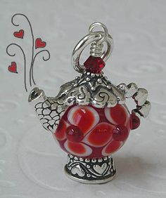 Teapot pendants. The Love Teapot says 'Love' on the bottom and is covered with hearts.