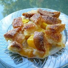 Too Easy Peach Cobbler - Made this tonight because I wanted something sweet. I made it with whole wheat bread. I only used 4 pieces of bread because I thought it was too much. I was wrong. Next time, I'll use 6.