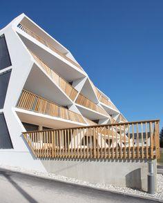 Zig-zagging balconies create sculptural facade for Ragnitzstrasse 36 apartment block