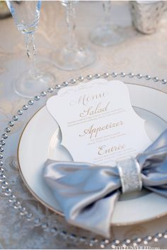 love the bow and the elegant menus by Laura Hooper Calligraphy via StyleUnveiled.com / Blue Horizon Studios / Elegant Wedding Inspiration