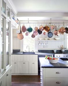 pot racks - it's time for them to come back - great for getting your hands on a cooking pot quickly.