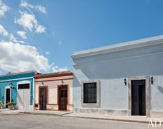 Blue Exterior Inspiration The exterior David Serrano and Robert Willson's Mérida, Mexico, home is painted in a Farrow & Ball pale blue. A black front door adds contrast to the façade of the house, which was renovated by Bohl Architects. Spanish Architecture, Facade Architecture, Building Exterior, Building A House, Pastel Paint Colors, Mexico House, Exterior Paint Colors For House, Tropical Paradise, Architectural Digest