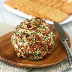 Bacon-Jalepeno Cheese Ball ~ 6 slices Bacon, ¼ c chopped Pecans, 8 oz Cream Cheese room temp, ½ c shredded Cheddar Cheese, 2 T chopped fresh Parsley, 1 Garlic Clove minced, ¼ tsp ground Cumin, pinch Cayenne Pepper, 1 tsp Lime Juice, ½ tsp Worcestershire Sauce, 2 Jalapeños ribs & seeds removed finely chopped & divided, Crackers.