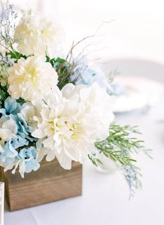 Blue Wedding Flowers 26 Refreshing Spring Wedding Centerpieces: a wooden box with blue hydrngeas, white dahlias and textural greenery is ideal for a rustic wedding Wooden Wedding Centerpieces, Blue Flower Centerpieces, Blue Flower Arrangements, Flower Decorations, Wedding Flower Guide, Beach Wedding Flowers, Wedding Ideas, Wedding Decor, Wedding Reception