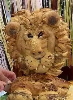 """3D Bread Sculptures""..... Competetive bakers are challenged to create elaborate bread masterpieces and some of the most amazing bread sculptures.  Paul Jagger's ""King of the Jungle"" bread sculpture is one example."