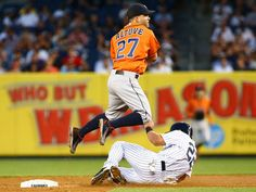 Houston Astros second baseman Jose Altuve (27) forces out New York Yankees center fielder Jacoby Ellbury (22) in the first inning against at Yankee Stadium.