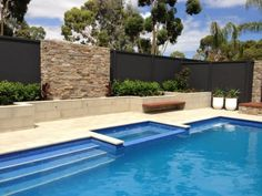 Having privacy & safety of the children in mind, a concrete wall & privacy fencing was set-up resort style backyard with a large pool with minimum fuss. Privacy Walls, Privacy Fences, Fencing, Backyard Privacy, Pool Fence, Backyard Pools, Backyard Ideas, Concrete Fence Wall, House Fence Design