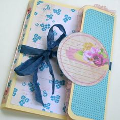 This project was created from an office supply file folder -it's a great base project that can be altered a dozen different ways to create fun and new mini books for all occasions!
