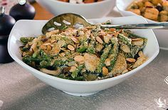Holiday Parmesan Green Bean Casserole - A Dream Dinners classic the whole family will enjoy! Whole green beans smothered in a creamy sauce with water chestnuts and parmesan cheese.  Topped with sliced almonds.